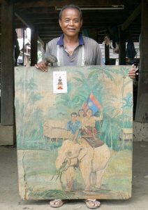 Boun Somsy, with a painting of his white elephant that was liberated by the wife of the country's first president.